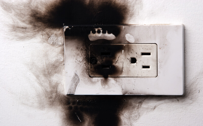 Outlet with fire damage.