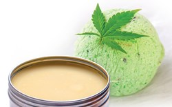 A photo of a tin of cannabis topical and a bath bomb.