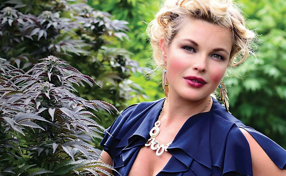 Cannabis influencer Mary Jean Dunsdon aka Watermelon poses with a cannabis plant.